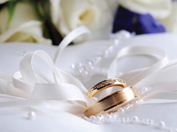 Image of wedding rings by Blass Photography